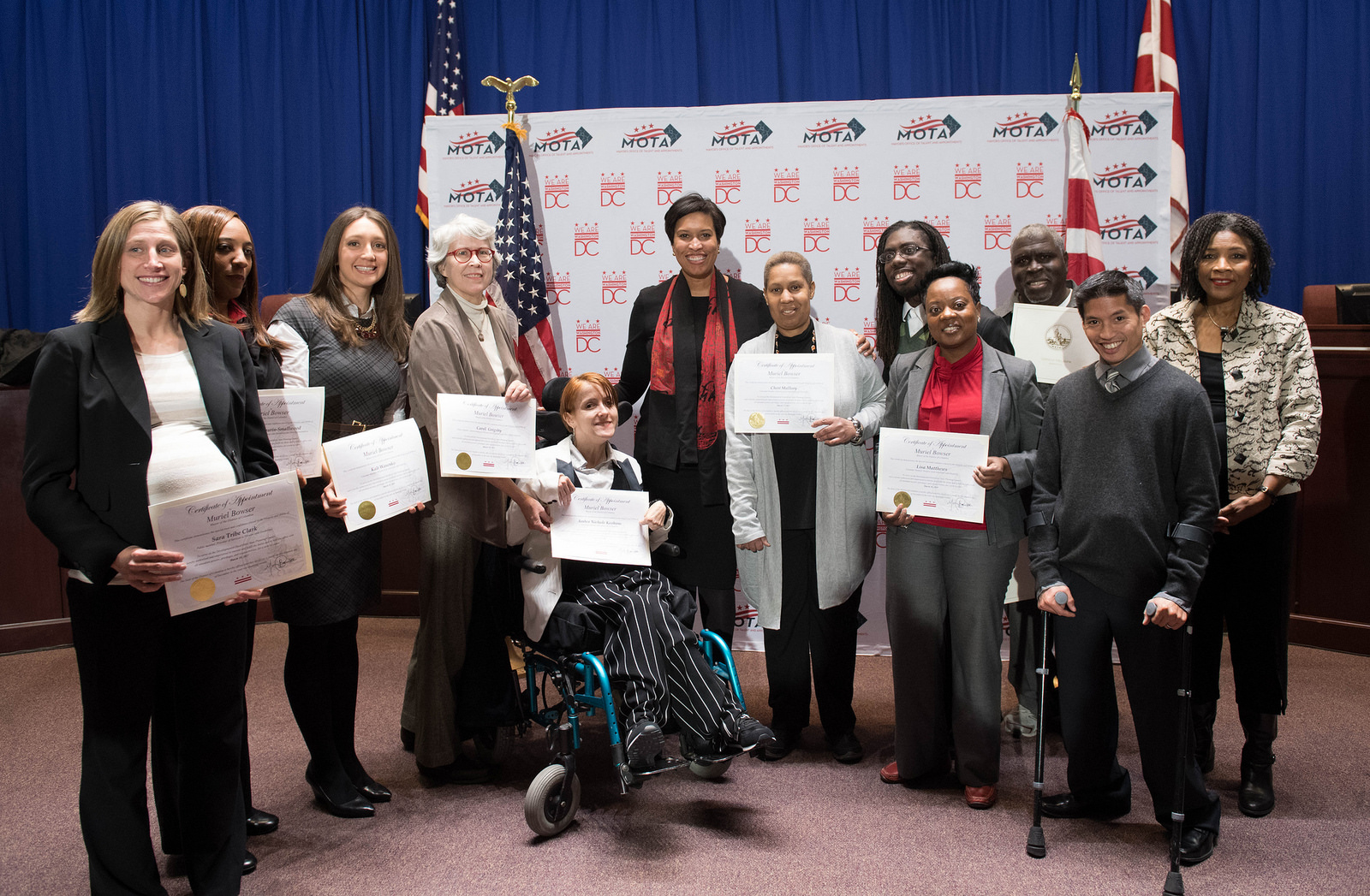 An image with several members of the Developmental Disabilities Council with Mayor Muriel Bowser after they were sworn in.