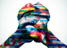 Banderas de paises latinoamericanos sobre manos abrochados - de Dreamstime