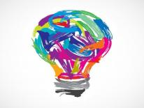 A light bulb drawn by many different color swooshes.